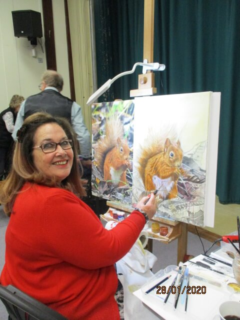Angel Gaughan painting a squirrel